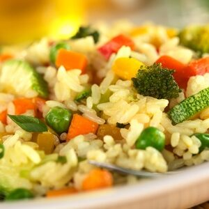11735835 - vegetable risotto made of zucchini, pea, carrot, red bell pepper, broccoli and pumpkin (selective focus, focus in the middle of the image)